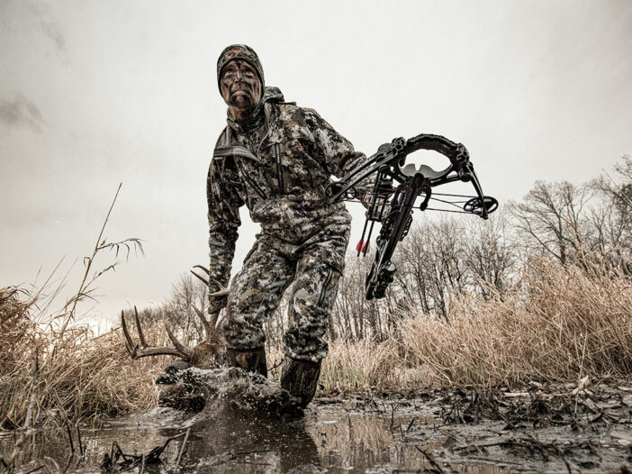 crossbow hunter with buck